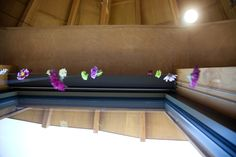 Bridal Shower decorations; purple & white & green, hanging flowers strung up with clear fishing line