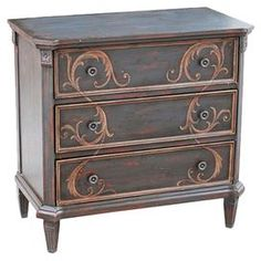 """Three-drawer wood chest with rosette medallions and fluted legs.  Product: ChestConstruction Material: Wood composites and select hardwoodsColor: BrownFeatures:  Canted posts with rosette medallionsThree framed drawersFluted tapered legs Dimensions: 38.5"""" H x 34.5"""" W x 16.5"""" DCleaning and Care: Dust with clean, soft damp cloth. Wipe immediately. To protect the finish, avoid the use of all chemical and household cleaners, rough cleaning pads, polishes and abrasives as they may damage the…"""