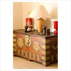 """""""GAP Interiors - Boonshill Farm, East Sussex. Antique Indian wood and brass dowry chest with lamp and ornamentals. - Picture library specialising in Interiors, Lifestyle & Homes"""""""
