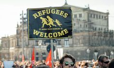 Supporters' groups in England are looking to follow the example set by their German counterparts in holding aloft 'Refugees Welcome' in response to the crisis gripping Europe