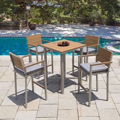 This outdoor patio bar set will help you entertain in style. It includes four tall chairs and a table for cocktails, games and lively chatter.