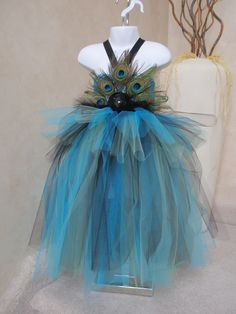 Peacock tutu dress/costume. Crocheted top with peacock feathers and flower. Matching witch hat or headband available