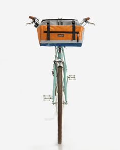 From Handbag to Handlebar Bag (and Back Again) — I would so get this if I had a bike.