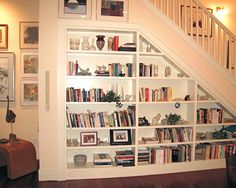 Other efficient and unique uses of space in the Habersham Townhomes create special design touches such as this built-in book shelve unit under the stairs.
