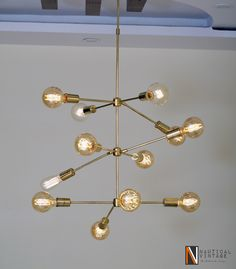 Mid-century Style Modern Brass 12 Arms Reef Chandelier Ceiling ight Fixture by Asiancraftsmen on Etsy https://www.etsy.com/listing/258844043/mid-century-style-modern-brass-12-arms