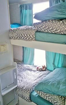 Thor Skamper, bunk beds ladder nice beddings,aqua curtains.travel trailer remodeling.
