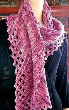 """Start this rectangular scarf in one corner and crochet it on the bias to the opposite corner. The special """"filet lace""""-style edging is crocheted as you go. Includes printer-friendly photo step-outs and a stitch diagram. Optional photo tutorial for lefties too! I originally designed Aeroette to be a practice pattern for a crochet class on the popular Aero Wrap. Like Aero, the scarf length and width are easy to adapt to the amount of yarn you have on hand. Crocheting a rectangular scarf on…"""