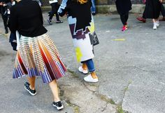 Mary Katrantzou dress and Dior sneakers; (right) Peter Pilotto coat and Adidas sneakers
