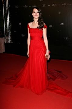 "MAY 16 2012 – Bérénice Béjo attended the opening ceremony in a Louis Vuitton red gown. <br/><br/><b><a href=""http://www.vogue.co.uk/galleries/3226"" target=""_blank"">SEE THE BEST BEAUTY LOOKS FROM CANNES 2011</a></b>"