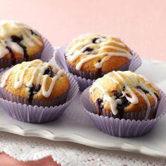 Glazed Lemon Blueberry Muffins Recipe -Bursting with berries and drizzled with a light lemony glaze, these muffins are moist, tender and truly something special. This is one recipe you simply must try for family and friends. —Kathy Harding, Richmond, Missouri