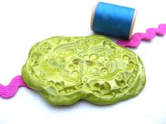 Clay ROCOCO CHARTREUSE art button  handmade from Pushing Buttons... A one of a kind piece that's perfect for your next crafting project!