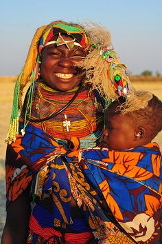 *A Beautiful Smile~~Mother and son, South West Angola, photograph by Luca Gargano