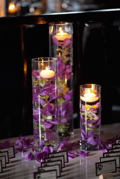 Love this escort card table in purple! Photo via Decozilla