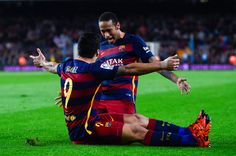 Luis Suarez of FC Barcelona celebrates with his teammate Neymar of FC Barcelona after scoring his team's third goal during the La Liga match between FC Barcelona and SD Eibar at Camp Nou on October 25, 2015 in Barcelona, Catalonia.