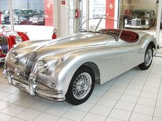 1956 Jaguar XK 140 Roadster. This is ALMOST the car I have lusted after all my life - I was looking for a 1956 'bottle green' version - and it was the coupe, not the 'roadster'... :)