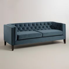 Large, comfortable and full of mid-century style, our Midnight Blue Kendall Velvet Sofa is polished and practical. This plush sofa features hand-tufted detailing on the back and arms, shelter arms, tapered solid wood legs and sumptuous velvet upholstery in a deep blue hue.