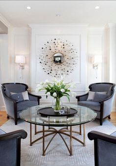 Robeson Design Interior Designers & Decorators. Love the 4 matching chairs, glass & brass coffee table. Lovely space.