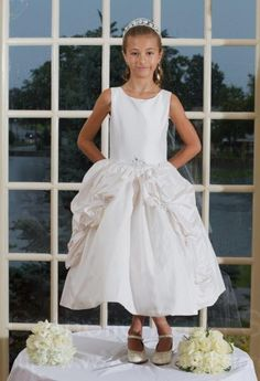 Amber Silk Couture First Communion Dress - Named after the precious Amber gem stone, this beautiful sleeveless dress features a scoop neckline with a classic yet elegant bodice.