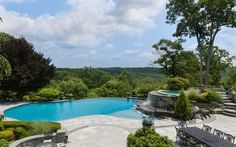 Pool envy! This magnificent infinity pool and hot tub is beyond gorgeous and over looks the country side of Bedford, NY.