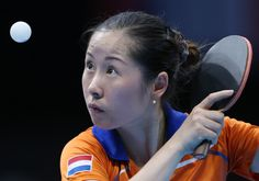 Netherlands' Jie Li returns serves o Egypt's Dina Meshref during the women's team table tennis competition at the 2012 Summer Olympics, Friday, Aug. 3, 2012, in London.