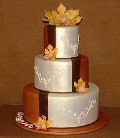 Brides: Fall Wedding Cakes :Walnut spice with cream cheese, cake by Kim Payne, topped with raspberries and walnuts and sugar paste flowers throughout the cake, airbrushed , fondant to mimic the feel of antique silk and copper , chocolate brown fondant separated the cake for a modern touch.