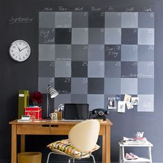 @livingetc - Home office with chalkboard wall  To make a statement in your home office and to get super-organised, paint a calendar on the wall above the desk with chalkboard paint. Use black and white chalkboard paint to mix different tones of grey to create an eye-catching effect that's easier to amend from month to month