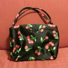 Cherry print makeup or accessory bag Very adorable cherry designed bag! Perfect for makeup or anything you desire! Has two big spaces for storage on the inside! One pocket on the outside. Excellent condition. soho Bags