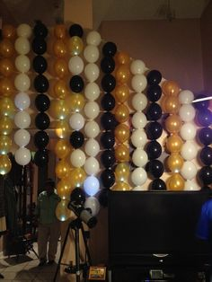 Balloons flowed from the second story balcony to provide a dramatic backdrop to a 60th Birthday Bash, that had LED lights inserted into the balloons!