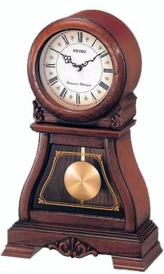 The Seiko Qxq005blh Mantel Clock Has A Dark Brown Solid Oak Case With Hand Rubbed