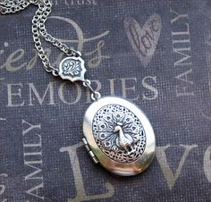 http://www.etsy.com/listing/62298553/silver-scent-locket-necklace-enchanted?ref=sr_gallery_15&sref=&ga_search_submit=&ga_search_query=PEACOCK&ga_order=most_relevant&ga_ship_to=US&ga_view_type=gallery&ga_page=13&ga_search_type=handmade&ga_facet=handmade%2Fjewelry