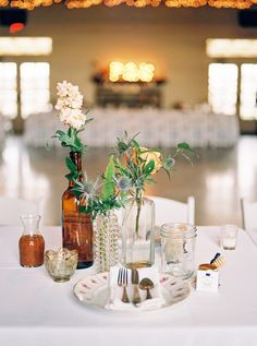 vignette inspired centerpieces - photo by Allen Tsai Photography http://ruffledblog.com/charming-eclectic-wedding-in-texas