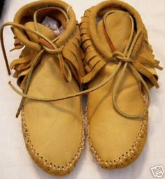HANDMADE BUFFALO SKIN MOCCASINS...remember wearing these? I did, and if the sidewalk was wet, they were slicker than snot!! LOL