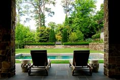 View from the pool house in this beautiful mature garden.  Pool surrounded by grass.
