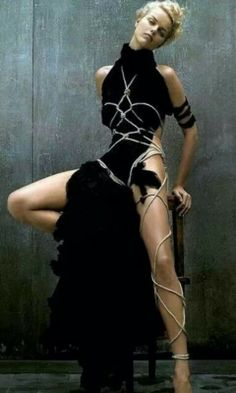 [Rope twisted over a primitive style black dress]