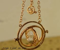 Harry potter time Turner necklaceRotate 360 degrees by itypeicool, $0.99
