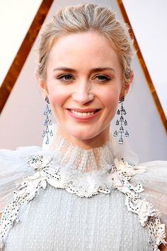 Oscars 2018 - Emily Blunt  Emily Blunt took a turn for the whimsical at the Academy Awards, with a raked-back romantic updo and soft, pretty makeup. The highlight? Her natural rosy pink lip.