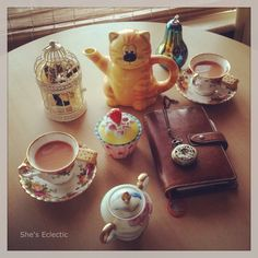 She's Eclectic: January Filofax photo-a-day challenge, day 14 - animal. My cat tea pot inspired a mad hatters tea party theme with country roses china, an Alice in wonderland pocket watch and my ochre Malden filofax.