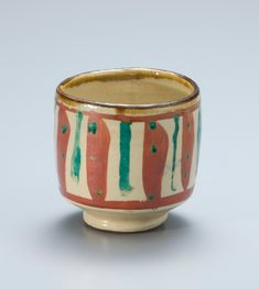 Shoji Hamada - Tea Bowl, slip enamels featuring red chilies and vertical green lines