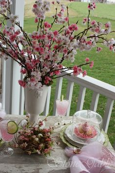Shabby Chic table setting for Spring! Incredibly talented woman (who shares my name) gorgeous landscapes. Love this cherry blossoms and pink lemonade setting. Stone Gables
