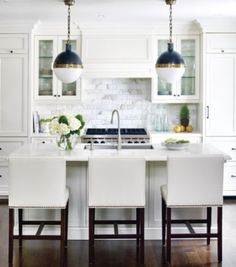 Small kitchen ideas - I like the glass cabnets with bench space underneath