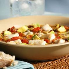 Bacalao, salted dried codfish, is the defining ingredient in traditional Puerto Rican fish stew, but salt cod requires overnight soaking and several rinses in cool water before it can be used, so we opt for fresh fish in this quick version.