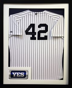 Yankees signed Mariano Rivera jersey preserved in classic black frame with custom cut mat.   Framed at Art and Frame Express in Edison, NJ