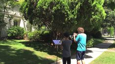 John Williams Greets Two Young Musicians Playing the Star Wars Theme Song Outside of His Home