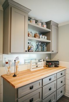 Sherwin Williams Dovetail painted cabinets.