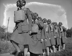 Personnel entering a gas chamber during a training exercise, No. 2 CWAC Basic…