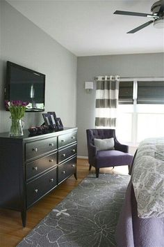 Grey Roman Shades are perfect for this bedroom