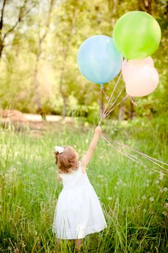 A 3 year old, a field, and balloons make for happy pictures.