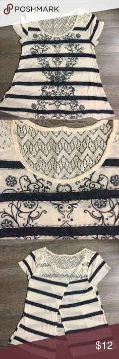 Women's flowered and striped shirt Women's medium cream colored shirt with navy stripes and flower design. Lace on top with a slit down the back that opens. Great condition. Tops