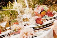 Peach centerpieces with glass candlesticks