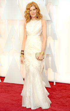 Rene Russo arrived in an ivory J. Mendel crew neck gown with an organza ruffled skirt. at the 2015 Academy Awards on Sunday, Feb. 22, in Hollywood.